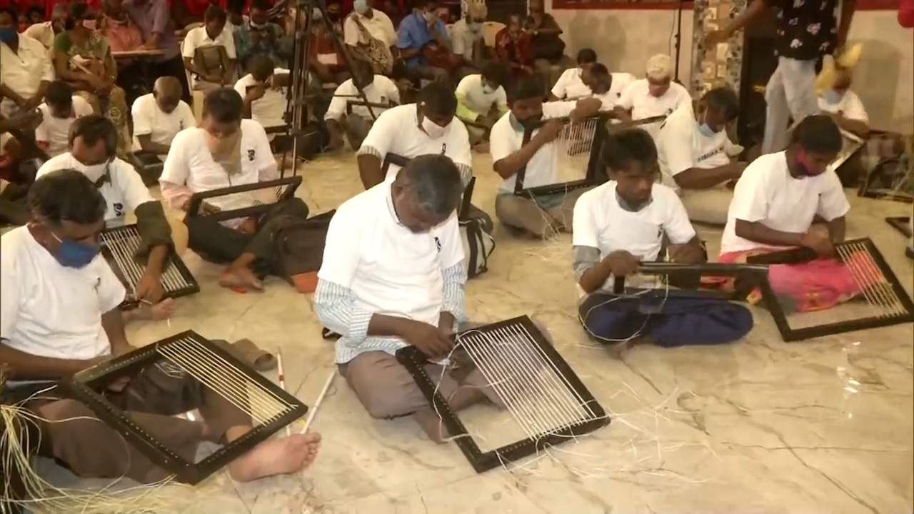 50 visually impaired people weave 50 chairs in 6 hours, attempt record