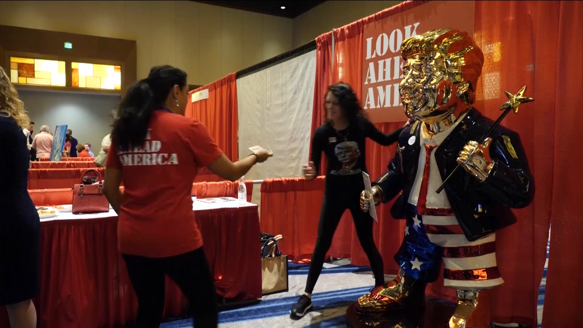 Republicans still loyal to Trump, unveil his gold statue at CPAC